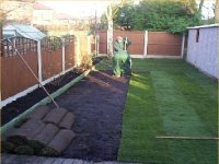 Garden fence using wooden panels, concrete posts and concrete gravel boards. Also turf laying.